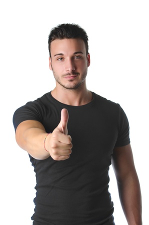 Handsome and muscular young man with thumb up doing OK sign, isolated on white photo