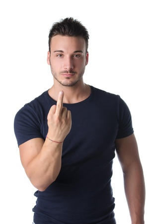 one finger: Handsome young man showing middle finger gesturing fuck