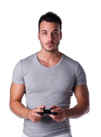 Attractive young man using joystick or joypad for videogames, isolated on white photo