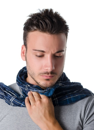 sore throat: Young man with scarf, holding his neck because of throat ache with suffering expression Stock Photo