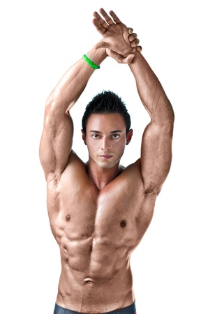 Attractive muscular young man with arms stretched up, isolated on white background photo