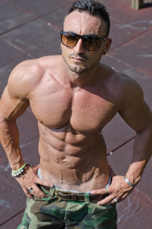 nipple man: Handsome, muscular bodybuilder seen from above, shirtless showing ripped pecs, abs Stock Photo
