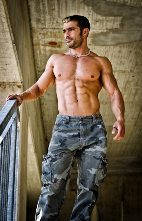 sexy construction worker: Hot, muscular construction worker shirtless seen from below Stock Photo