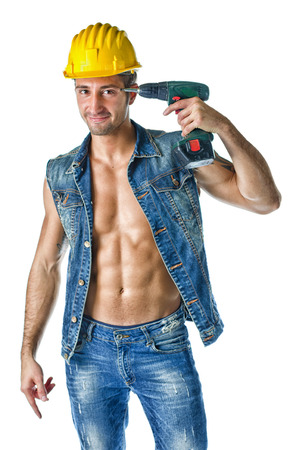 Attractive, muscular construction worker wearing open denim jacket, isolated on white photo