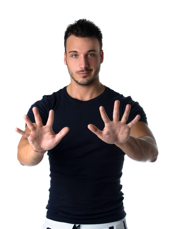 10 fingers: Attractive young man counting to ten with fingers and hands, isolated on white background