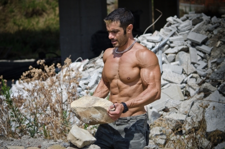Muscle man shirtless outdoors in building site  Construction worker photo