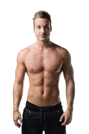 Attractive , shirtless young man with muscular body, showing pecs, abs and arms, isolated on white photo