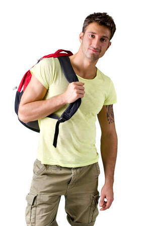 Attractive young man with backpack, isolated on white background, looking at camera photo