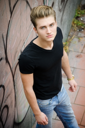 Attractive blond young man in city environment, shot from above photo