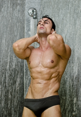 man shower: Muscular man having a shower, wearing only underwear