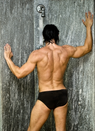 shower man: Muscular man having a shower, seen from the back Stock Photo