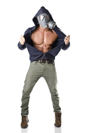 Muscular man wearing antigas mask, opening sweatshirt on ripped torso, isolated on white photo