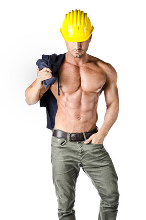 Attractive, muscular construction worker shirtless, wearing yellow hard hat, isolated on white photo