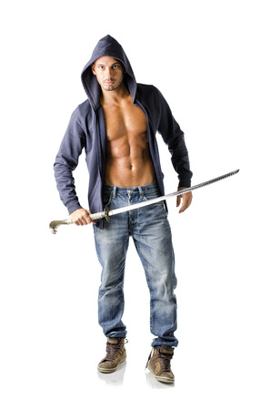 hooded sweatshirt: Full body shot of attractive young man in sweatshirt holding japanese sword, isolated