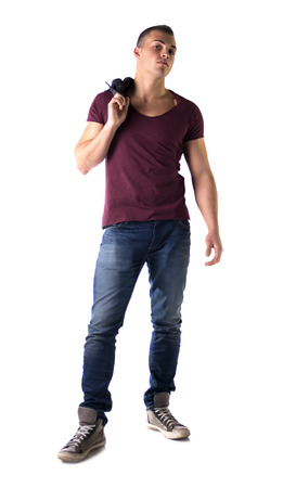 Full body shot of handsome young man with t-shirt and jeans, isolated on white photo