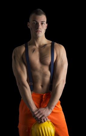 Handsome young topless construction worker photo