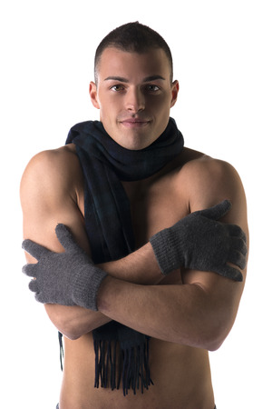 Attractive shirtless young man with wool winter gloves and scarf, isolated on white Stock Photo