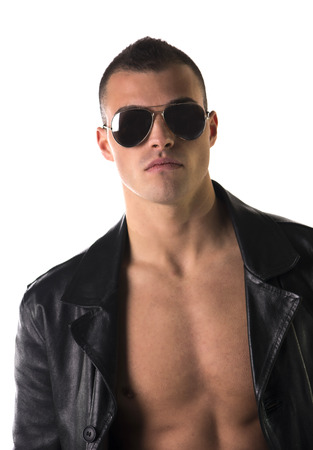 Attractive young man shirtless, wearing black leather trench  photo