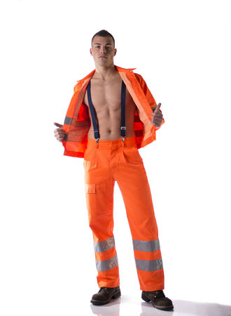 Full body shot of athletic young construction worker with orange suit  photo