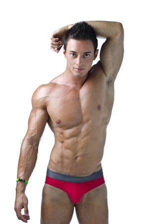 bathing   suit: Cute muscular ripped young bodybuilder in bathing suit, looking at camera Stock Photo