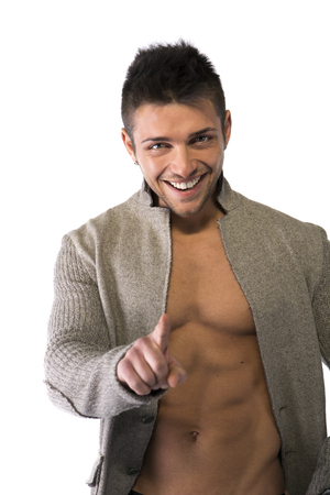 pecs: Confident, smiling young man with open sweater on muscular torso, ripped abs and pecs, pointing finger to camera