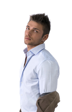 Profile shot of handsome young man with shirt, taking off jacket, isolated photo