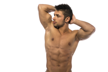 arms behind head: Cute muscular ripped young bodybuilder with hands behind his head, looking away. Isolated on white Stock Photo