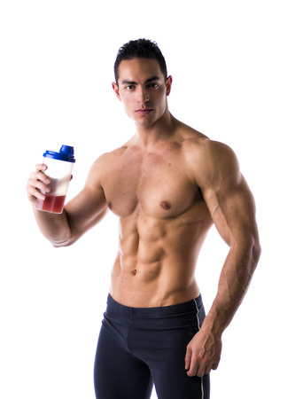 Muscular shirtless male bodybuilder holding protein shake bottle, ready for drinking. Isolated on white, looking at camera photo