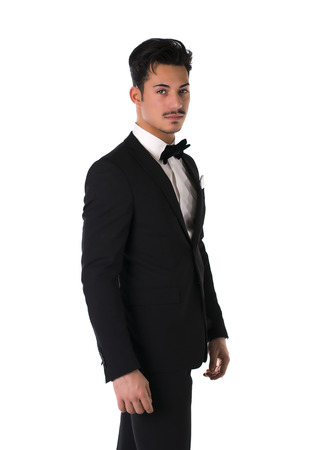 bowtie: Handsome elegant young man with suit and bow-tie, isolated on white Stock Photo