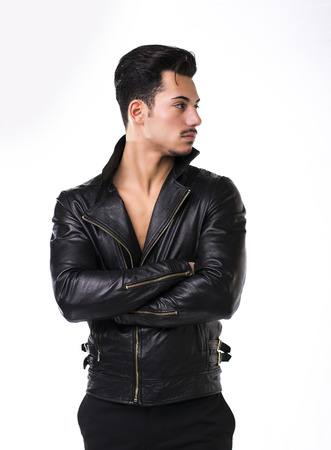 Attractive young man with leather jacket on  torso, isolated and looking to a side photo