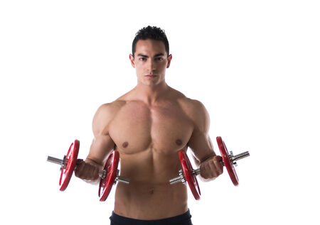 Muscular sexy shirtless young man exercising biceps with dumbbells, isolated on white  Stock Photo - 27634741