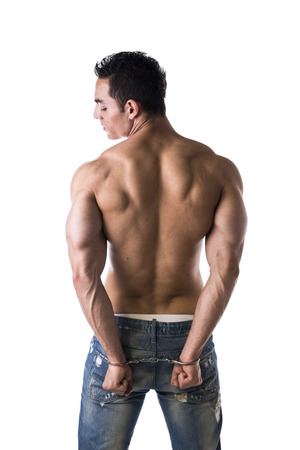 arrested criminal: Muscular back of male bodybuilder handcuffed, isolated on white Stock Photo