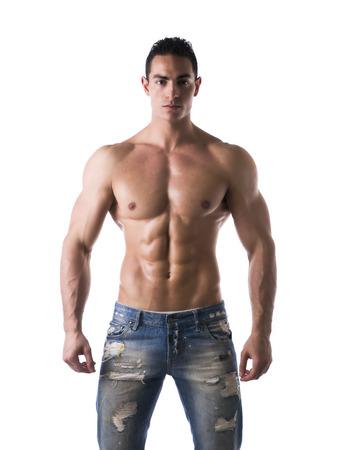 上半身裸筋肉の若い男のジーンズ、リラックスしたポーズは、白で隔離される前頭ショット 写真素材