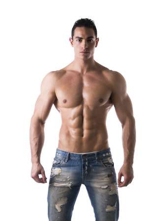 Frontal shot of shirtless muscular young man in jeans, relaxed pose, isolated on white photo
