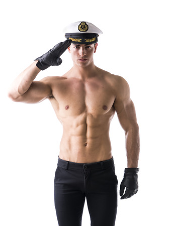 Muscular shirtless male sailor with nautical hat, isolated on white photo