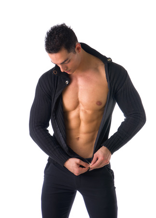 pecs: Confident, attractive young man zipping open sweater on muscular torso, ripped abs and pecs Stock Photo