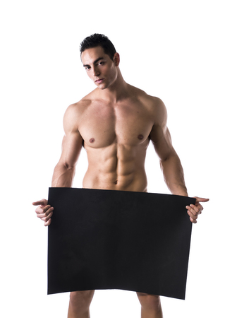 Naked young male bodybuilder holding blank black sign, large copyspace photo