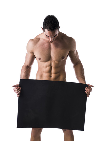 young male bodybuilder holding blank black sign, large copyspace photo