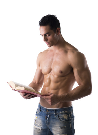exercise book: Muscular shirtless male bodybuilder reading book, isolated on white background
