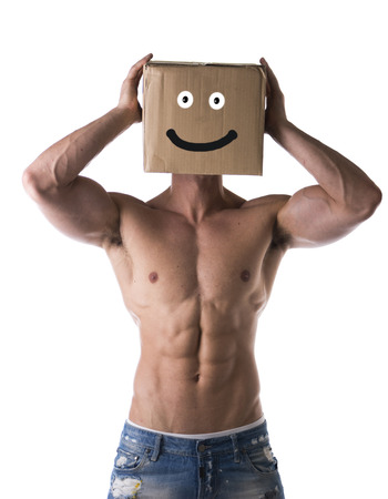 Muscular shirtless bodybuilder with smiling cardboard box on his head, isolated on white photo