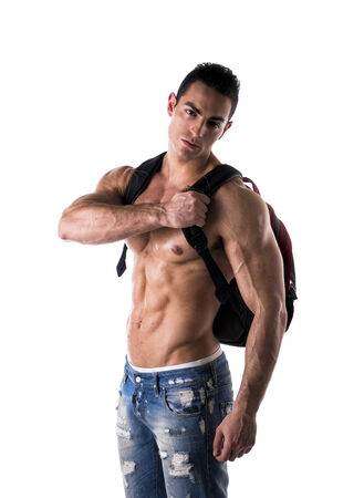 Shirtless muscular young man with rucksack on his back looking at camera, isolated photo