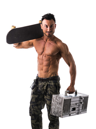 blaster: Shirtless muscular man with skateboard and big boombox radio (or ghetto blaster) Stock Photo