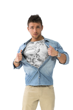 Handsome young man opening shirt on chest like a superhero, isolated photo