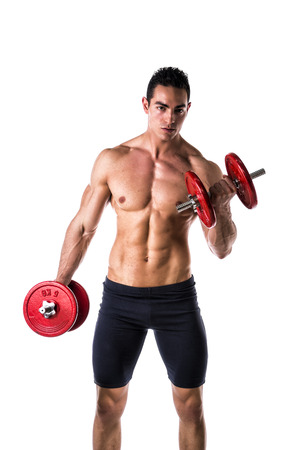 Muscular sexy shirtless young man exercising biceps with dumbbells, isolated on white  photo