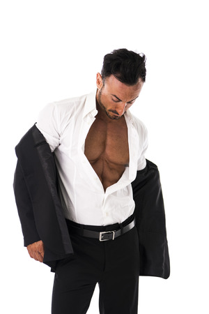 Businessman opening his shirt revealing muscular torso, on white background Stock Photo