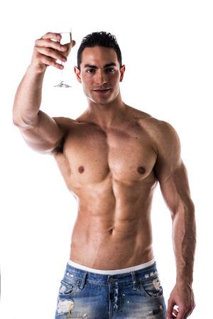 flauta: Hombre musculoso guapo sin camisa romántica joven que ofrece una copa de champagne a la cámara con una sonrisa aislados en blanco Foto de archivo