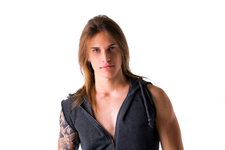 Beautiful young long haired man in jacket posing isolated on white Stock Photo
