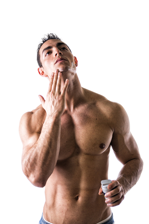 metrosexual: Man with muscular chest and abs applying shaving cream on his face on white background Stock Photo