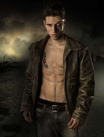 Young Handsome Robotic Man Wearing Leather Jacket Showing Body Abs While Looking at the Camera on Crashed City . Standard-Bild