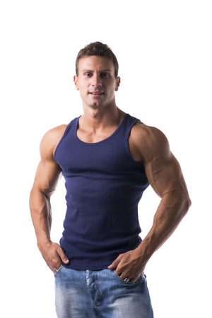 pectorals: Handsome bodybuilder smiling at camera isolated on white background wearing t-shirt and jeans